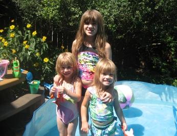 Gratuitous shot of my kids enjoying the backyard pool.