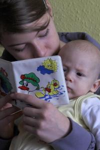 mother and baby reading
