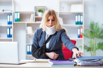 Injured female employee working in the office